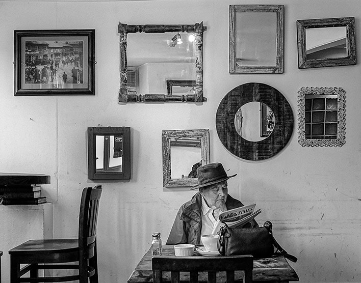 Man Reading His Newspaper